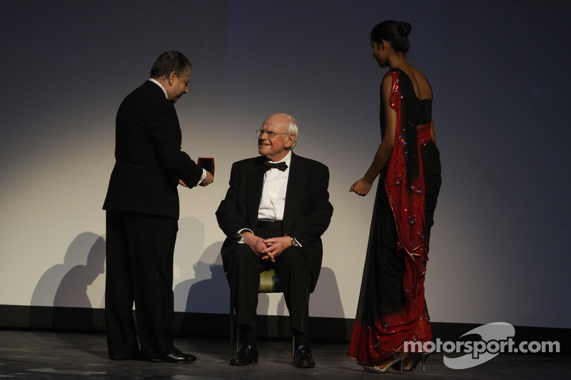 FIA President Jean Todt presents Professor Sid Watkins with the FIA Academy Gold Medal for Motorsport