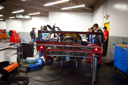 Chip Ganassi Racing team members work on the damaged #01 Chip Ganassi Racing with Felix Sabates BMW Riley