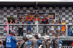 Podium: race winner Jamie Whincup, second place Will Davison, third place Garth Tander