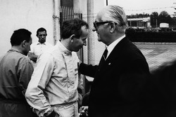 John Surtees with Ferrari team boss Enzo Ferrari talk in the pits
