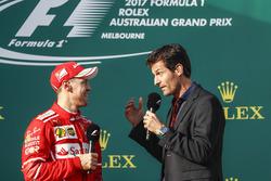 Sebastian Vettel, Ferrari, 1st Position, is interviewed by Mark Webber on the podium