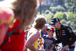 Esteban Ocon, Force India, poses for a picture, a young fan