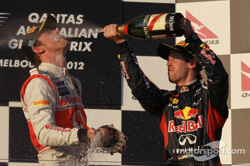 Jenson Button, McLaren Mercedes en Sebastian Vettel, Red Bull Racing