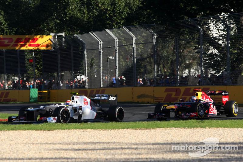 Sergio Pérez, Sauber F1 Team y Sebastian Vettel, Red Bull Racing