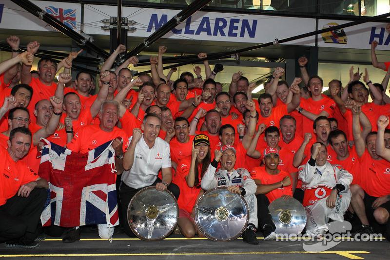 The McLaren team celebrate Jenson Button, McLaren Mercedes win, with John Button, Martin Whitmarsh,