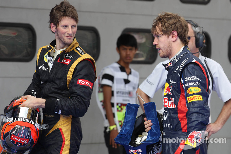 Romain Grosjean, Lotus Renault F1 Team en Sebastian Vettel, Red Bull Racing