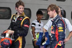 Romain Grosjean, Lotus Renault F1 Team and Sebastian Vettel, Red Bull Racing