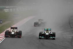 Pedro de la Rosa, HRT Formula One Team and Nico Rosberg, Mercedes GP