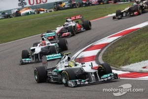 Nico Rosberg, Mercedes AMG F1 leads Michael Schumacher, Mercedes AMG F1 at the start of the race