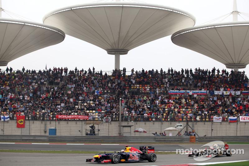 Sebastian Vettel, Red Bull Racing en Romain Grosjean, Lotus F1 Team