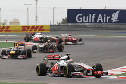 Lewis Hamilton, McLaren leads Mark Webber, Red Bull Racing