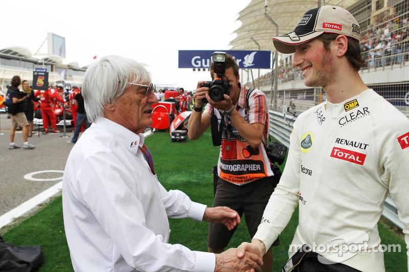 Bernie Ecclestone, CEO Formula One Group, with Romain Grosjean, Lotus F1 Team on the grid