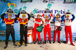 GT podium: class winners Emil Assentato and Jeff Segal, second place Dane Cameron and Wayne Nonnamaker, third place John Edwards and Robin Liddell
