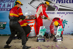 GT podium: class winners Emil Assentato and Jeff Segal celebrate with champagne