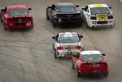 #61 Roush Performance Mustang Boss 302R: Billy Johnson, Jack Roush Jr., #01 CKS Autosport Camaro GS.R: Lawson Aschenbach, Eric Curran, #02 Starworks Motorsport Mustang Boss 302R: Lucas Luhr, Alex Popow battle