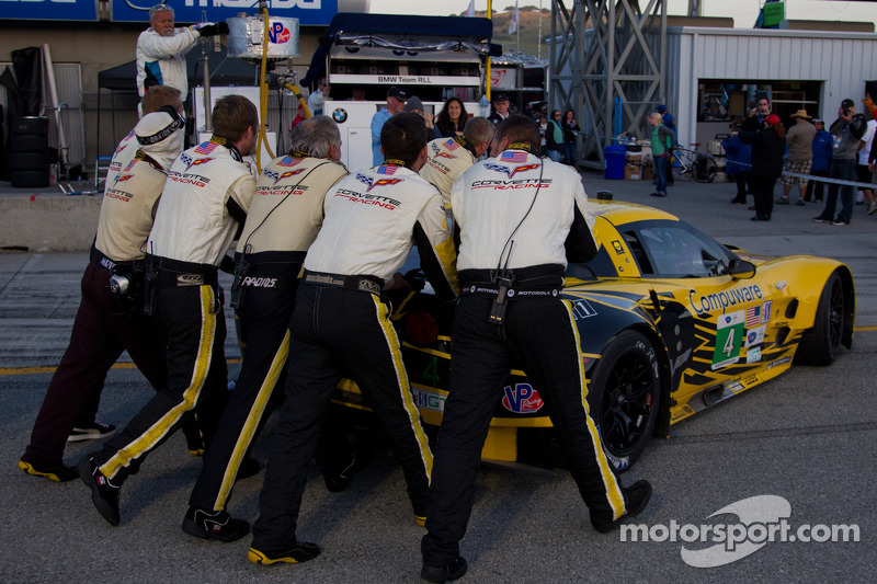 Corvette crew moving the winning GT car back to the garage