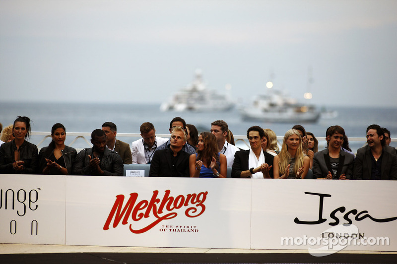Heikki Kovalainen, Caterham met vriendin Catherine Hyde, Williams; op de Amber Lounge Fashion Show