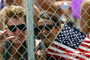 Fans through the fence