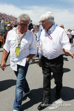 Mario Andretti, with Bernie Ecclestone, CEO Formula One Group, on the grid