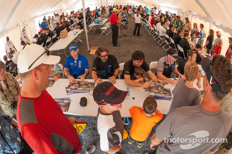 Fans get autographs from the Grand-Am drivers