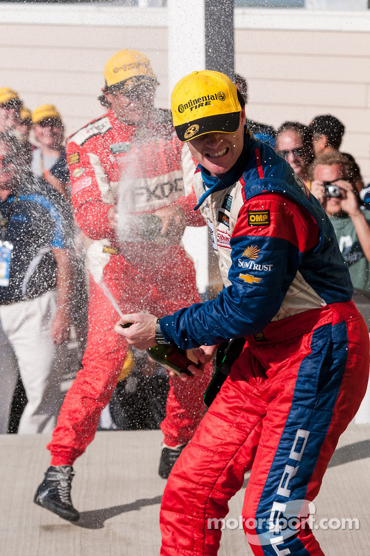 Robin Liddell sprays champagne