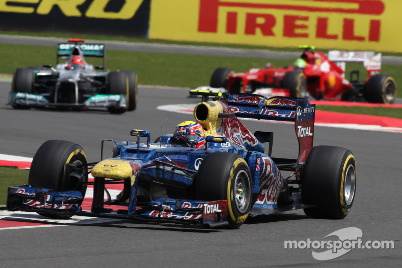 Mark Webber, Red Bull Racing leads Michael Schumacher, Mercedes AMG Petronas
