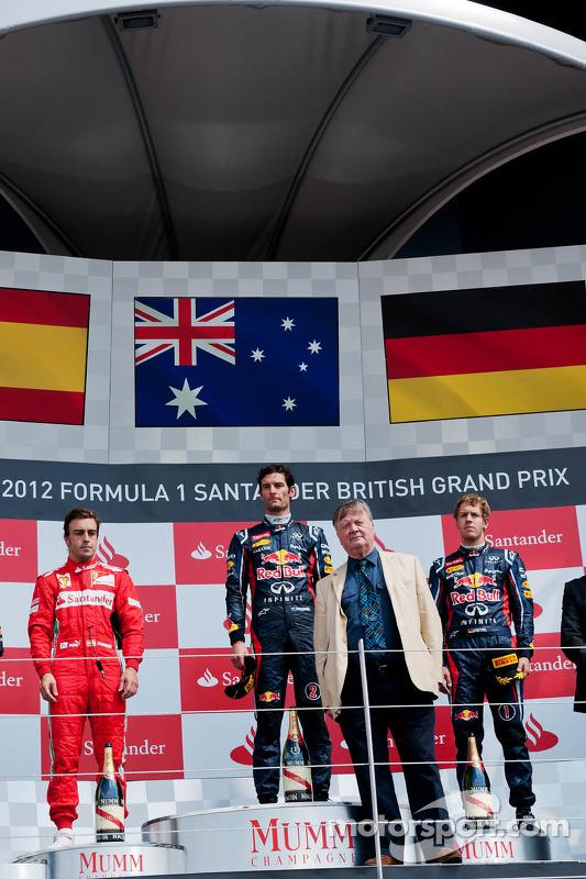 The podium, Fernando Alonso, Ferrari, second; Mark Webber, Red Bull Racing, race winner; Sebastian V