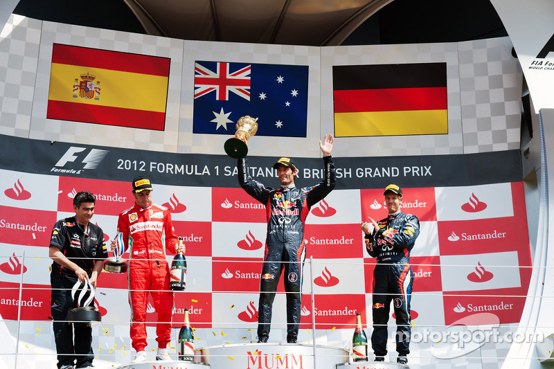 The podium, Fernando Alonso, Ferrari, second; Mark Webber, Red Bull Racing, race winner; Sebastian Vettel, Red Bull Racing, third.
