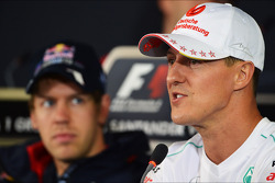 Michael Schumacher, Mercedes AMG F1 and Sebastian Vettel, Red Bull Racing in the FIA Press Conference