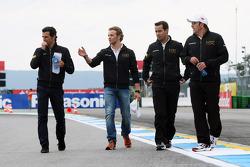 Pedro De La Rosa, HRT Formula 1 Team, and Dani Clos, HRT Formula One Team Test Driver walk the circuit