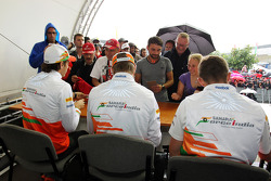 Jules Bianchi, Sahara Force India F1 Team Third Driver; Nico Hulkenberg, Sahara Force India F1; and Paul di Resta, Sahara Force India F1 sign autographs for the fans