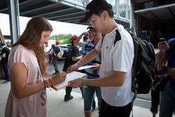 Cyndie Allemann signs autographs