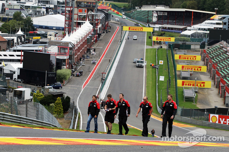 Timo Glock, Marussia F1 Team, walks the circuit and climbs Eau Rouge