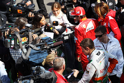 Paul di Resta, Sahara Force India F1 and Fernando Alonso, Ferrari with the media