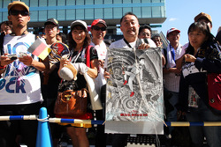 Fans of Michael Schumacher, Mercedes AMG F1 at the pit lane walkabout