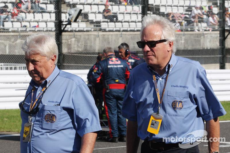Herbie Blash, FIA Delegate met Charlie Whiting, FIA Delegate op de grid