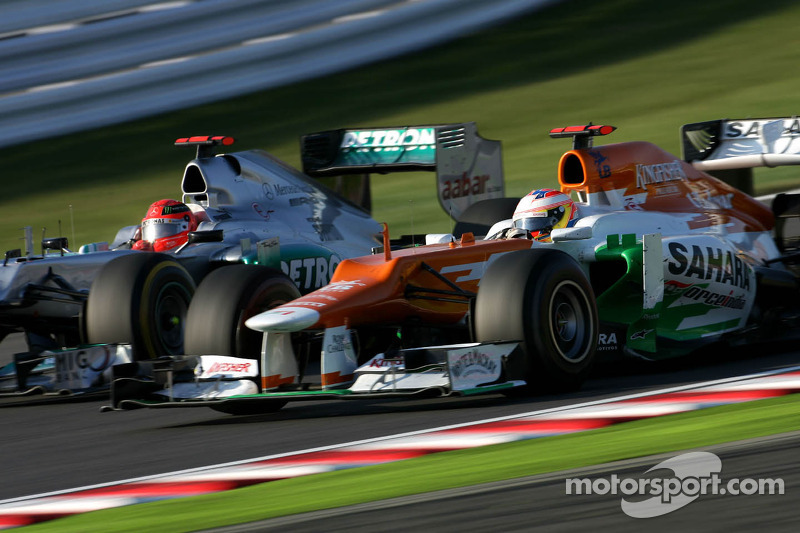 Michael Schumacher, Mercedes GP and Paul di Resta, Sahara Force India Formula One Team