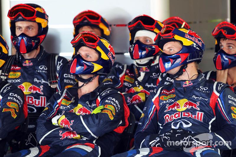 Red Bull Racing mechanics watch the race