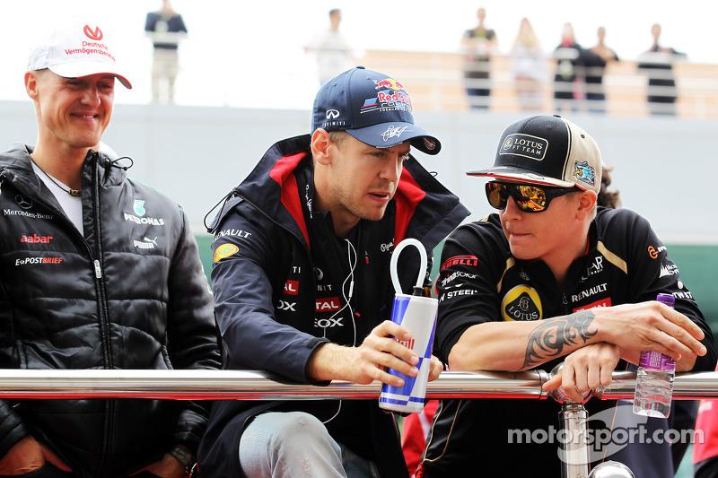 Michael Schumacher, Mercedes AMG F1 with Sebastian Vettel, Red Bull Racing and Kimi Raikkonen, Lotus