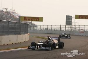 Pastor Maldonado, Williams leads team mate Bruno Senna, Williams