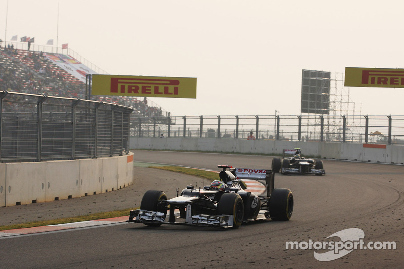Pastor Maldonado, Williams leads team mate Bruno Senna, Williams