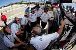 Alex Job Racing team members watch qualifying