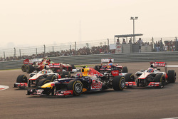 Mark Webber, Red Bull Racing leads Jenson Button, McLaren and Lewis Hamilton, McLaren at the start of the race