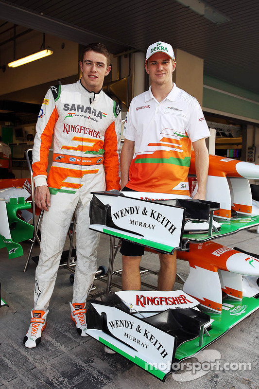 Paul di Resta, Sahara Force India F1 and team mate Nico Hulkenberg, Sahara Force India F1 with competition winners Wendy and Keith Murray branding on the Sahara Force India F1 VJM05