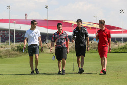 Dean Fiore, Michael Caruso, Rick Kelly and James Courtney take time out for a bit of golf at the Yas country club