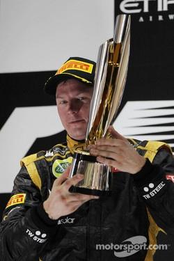 Race winner Kimi Raikkonen, Lotus F1 Team celebrates on the podium
