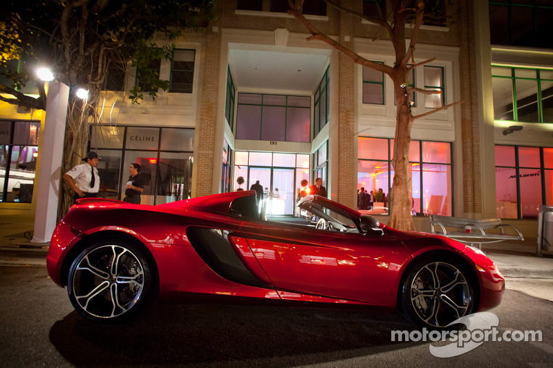 A McLaren MP4-12C in front of the Moore Building