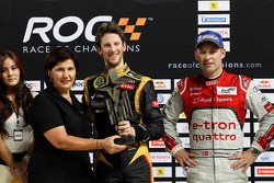 Winner Romain Grosjean celebrates with second place Tom Kristensen and Michel Mouton