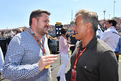 Paul Hembery, Pirelli Motorsport Director and Jean Alesi, on the grid