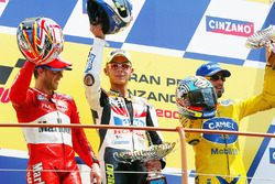 Podium: winner Valentino Rossi, second place Loris Capirossi, third place Max Biaggi